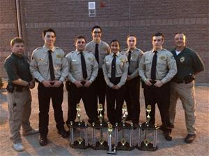 Explorer officers standing around five trophies that are sitting on the ground
