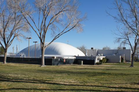 An outdoor photograph of the Swimming and Racquetball complex on a beautiful day with blue skies.